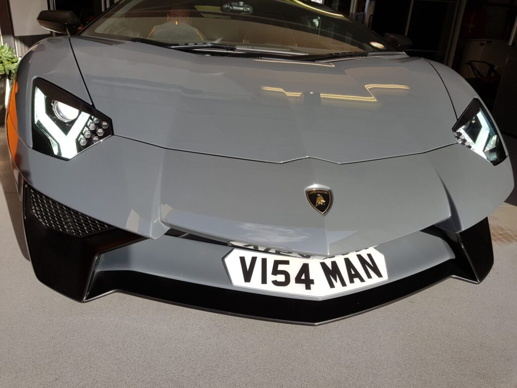 shaped number plate